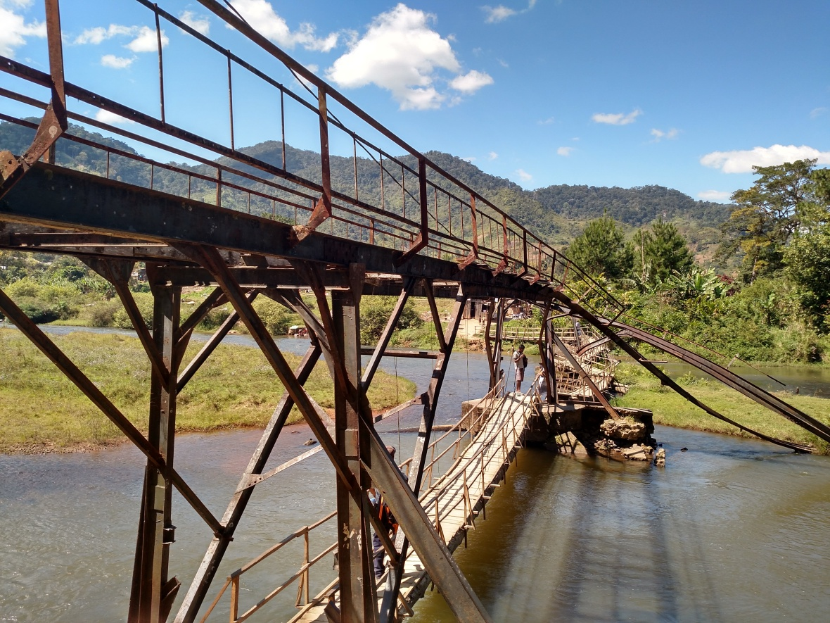 Rickety metal bridge over the river outside Ranomafana National Park, Madagascar